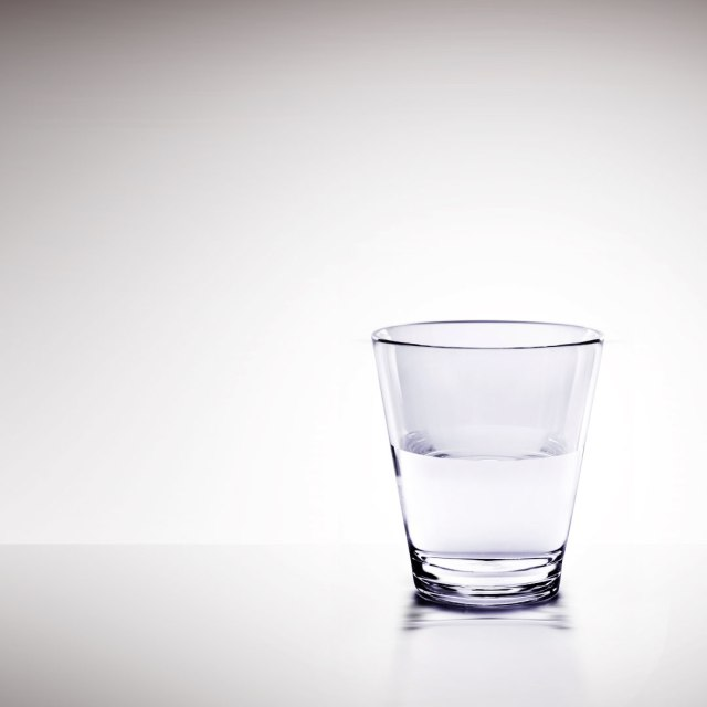 A water glass that's filled half way